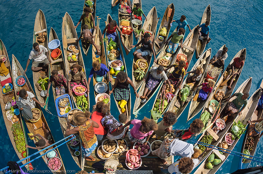 Floating market at the stern of a ship by Liz Harlin on 500px.com