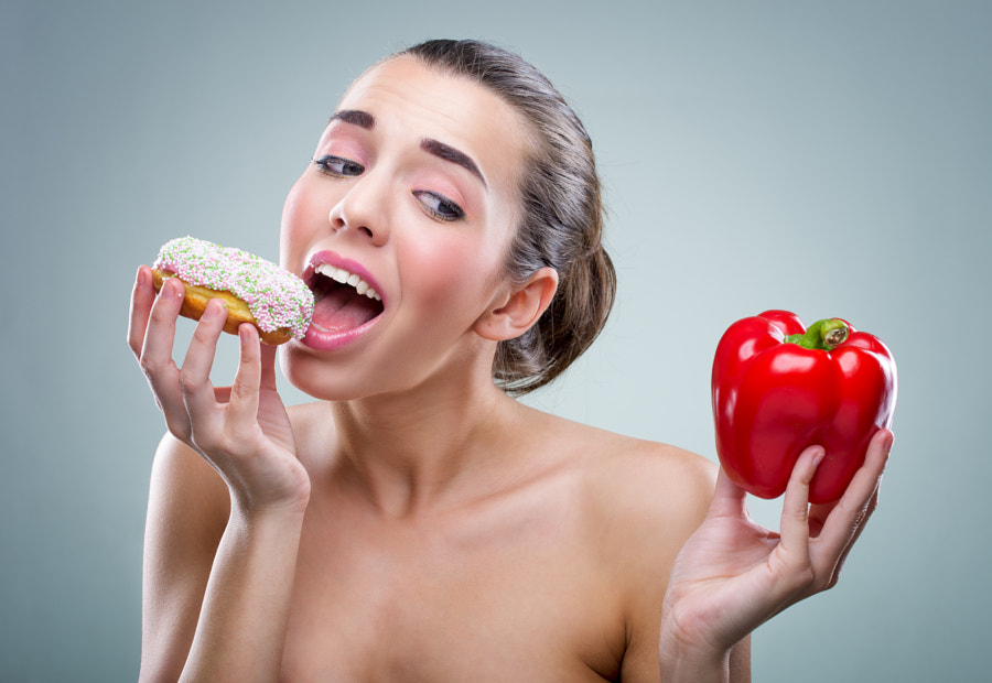 Photograph Women's diet. Donut or bell peppers ? by Gergely Zsolnai on 500px