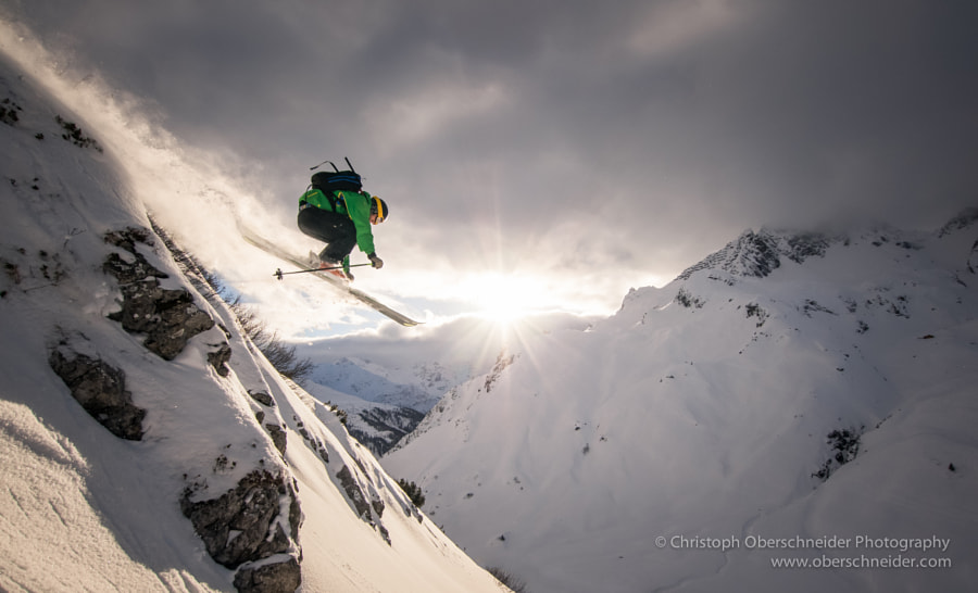 Photograph Arlberg Powder Skiing Jump by Christoph Oberschneider on 500px