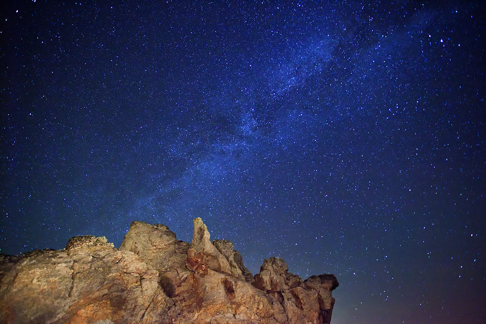 Photograph Milky Way... On the rock by Alvaro Roxo on 500px