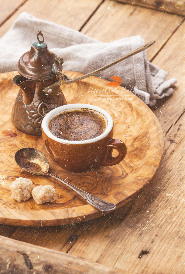 Cup of black coffee and Cezve