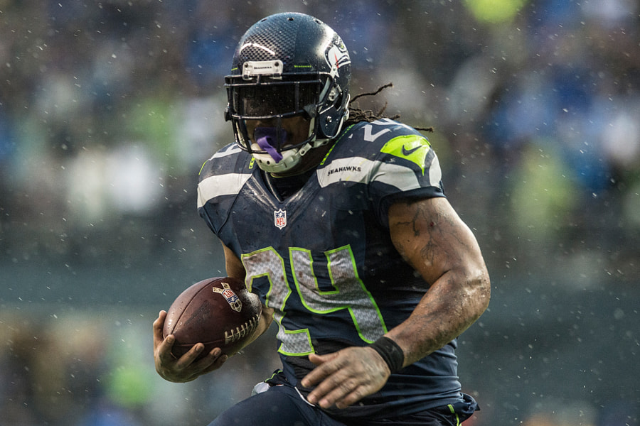 Photograph Beastmode in the rain: Marshawn Lynch by Matt McDonald on 500px