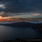Dramatic autumn sunset at Santorini from Imerovigli area overlooking Oia