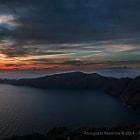 Dramatic autumn sunset at Santorini from Imerovigli area overlooking Oia