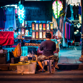 Vendor selling colorful lamps on the street in Bangkok, Thailand