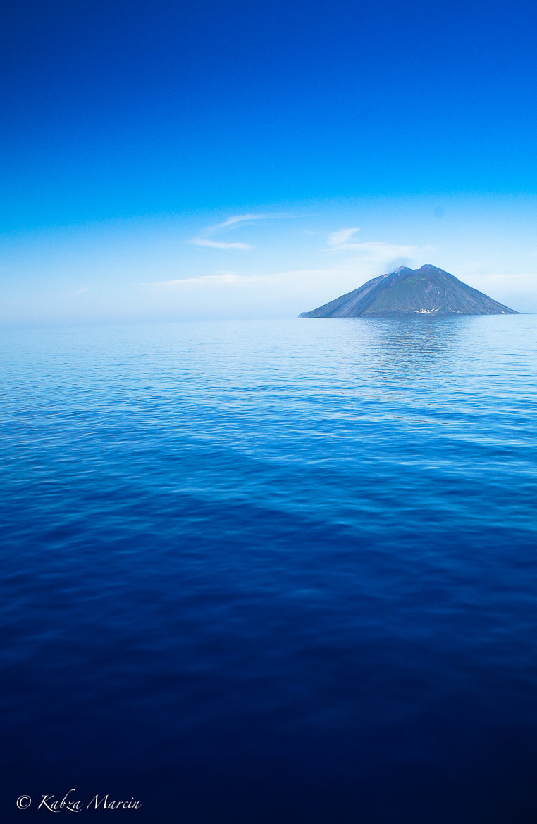 Photograph Stromboli Vulcan: smoking alone in the blue by Marcin Kabza on 500px