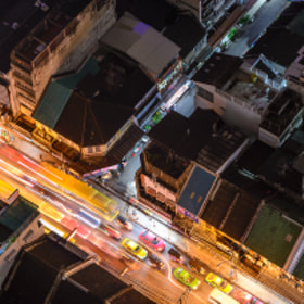 Overhead view of Bangkok, Thailand streets at night illuminated by busy traffic