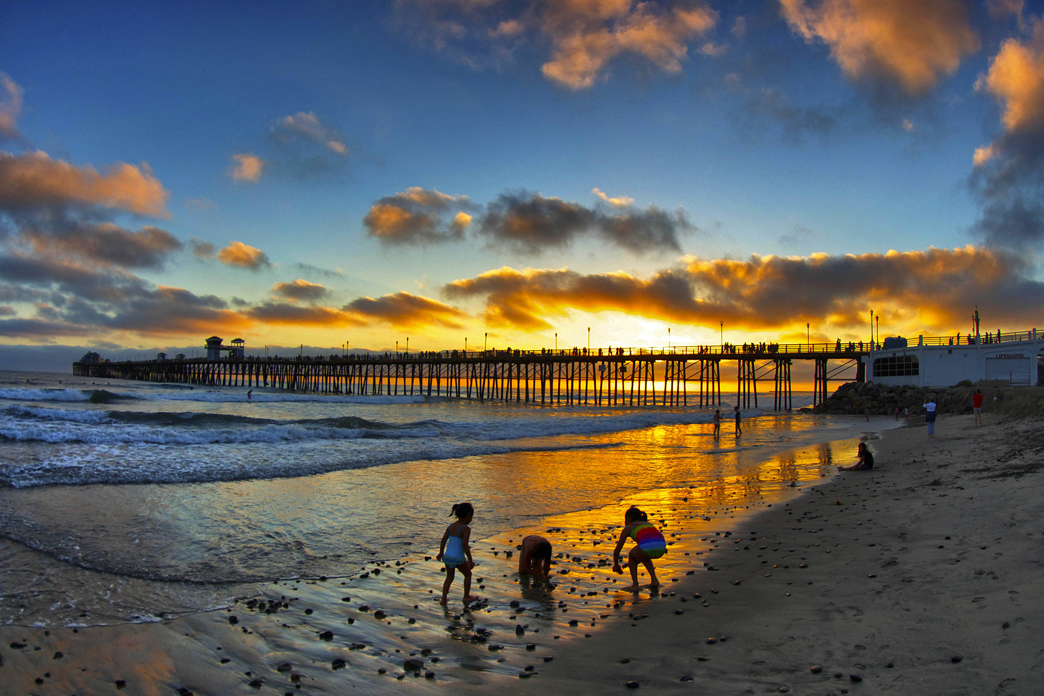 Photograph Kids Play in the Surf at Sunset - June 28, 2012 in Oceanside by Rich Cruse on 500px