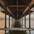A summers morning under Paignton Pier, Devon, England.