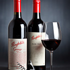 Here are two outstanding modern vintages of Penfolds' flagship red wines: Penfolds Grange 2006 (shiraz) and Penfolds Bin 707 (cabernet).  I have tasted both (this vintage of Grange twice), and both years were exceptional vintages in the Barossa Valley and surrounds.  The 2006 Grange consists of fruit from the Barossa Valley, Coonawarra and Magill, while the 2008 Bin 707 consists of fruit from Coonawarra, the Barossa Valley and Wrattonbully.  Lighting information:  1. Canon Speedlite 580EX II set to 1/16th power and 24mm zoom, positioned 45 degrees camera right at a distance of 30-40cm, fired through a 40 x 30cm softbox and triggered with a PocketWizard PLUS II  2. Canon Speedlite 580EX set to 1/128th +0.3 power and 80mm zoom, positioned behind the subject and pointed at the backdrop, fired bare and triggered with a PocketWizard PLUS II.  3. 80cm white reflector dish placed at 90 degrees camera left, 20cm from the subject.