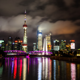Waibaidu Bridge with Skyline by PHOTONPHOTOGRAPHY  - Viktor Lakics (PhotonPhotography)) on 500px.com