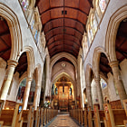 A continuation of my photographic study of St Peter's Anglican Cathedral in Adelaide.  This ultra-wide view looks down the nave of the magnificent cathedral, showing the timber work on the roof, as well as the stonework of the arches upon approach to the altar.