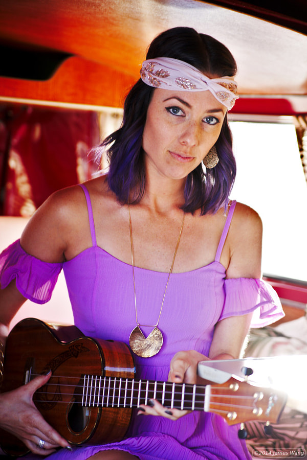 Lauren in her immaculate '74 VW bus, playing the ukelele.