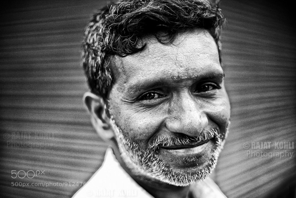 Photograph smiling garland seller by Rajat Kohli on 500px