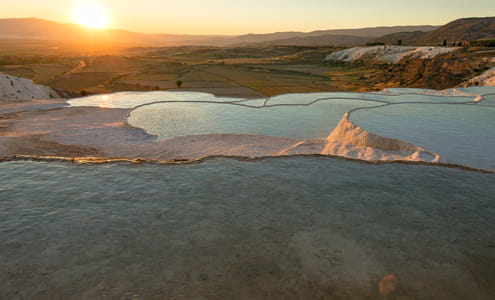 Carbonate travertines with blue water, Pamukkale, Turkey at sunset by Natta Summerky on 500px