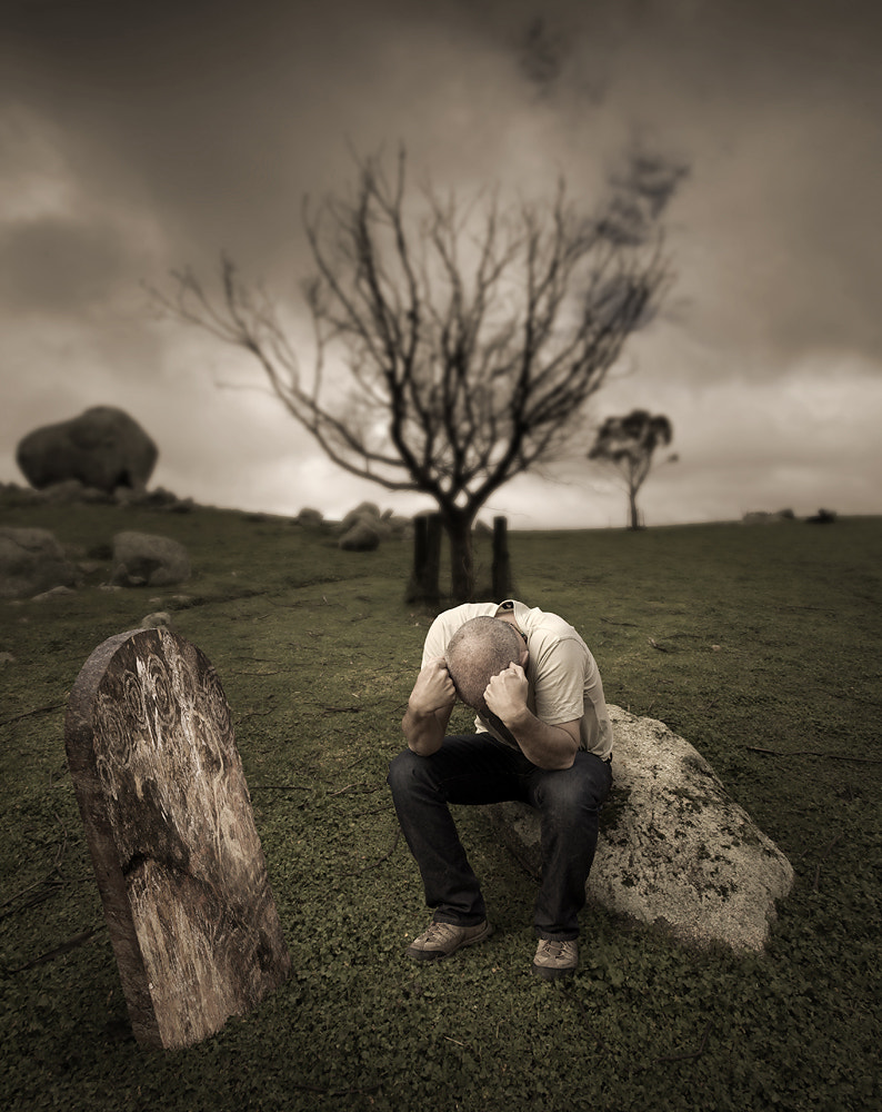 Photograph Old man crying at his own graveside by Richard Baxter on 500px