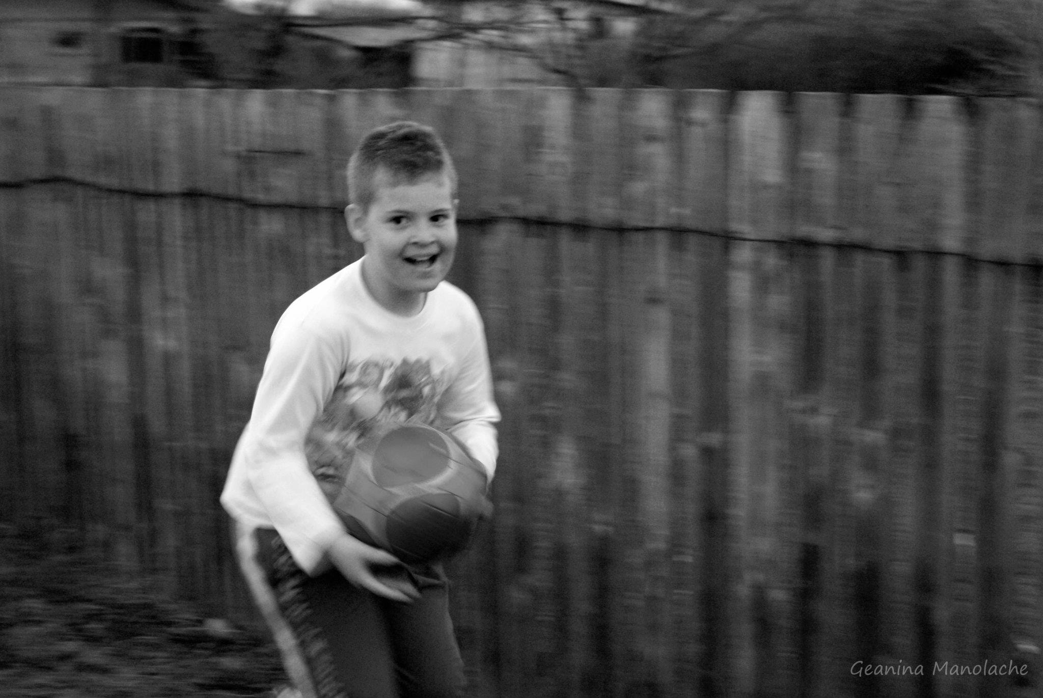 Photograph kid with ball by Geanina Manolache on 500px