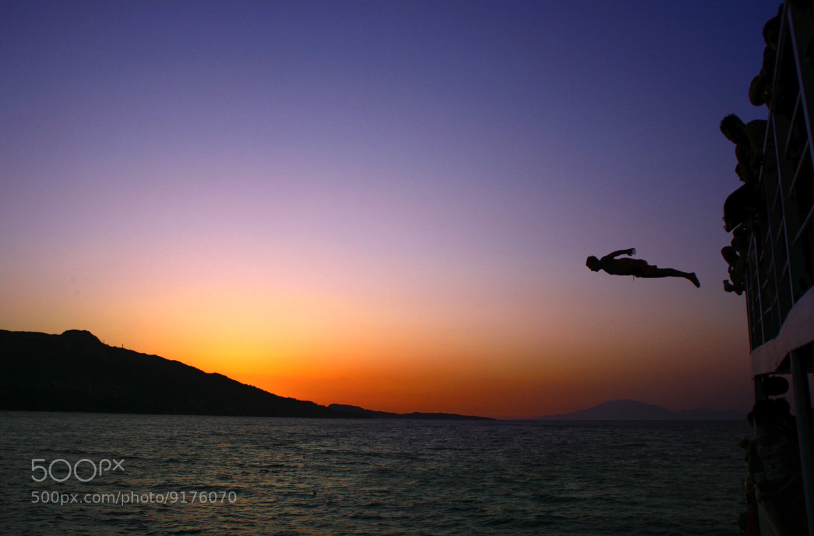 Photograph Sunset dive by Robert Tarpescu on 500px
