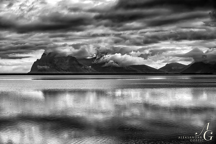 Vesturhorn in East Iceland in a futile attempt to shred the endless Atlantic clouds
