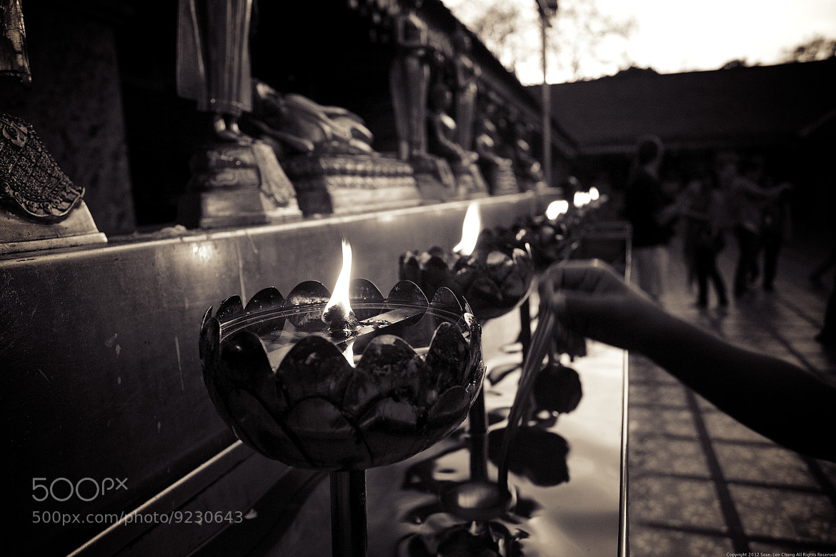 Photograph Monastery Oil Candles Lit For Prayers In Thailand by Sean Cheng on 500px