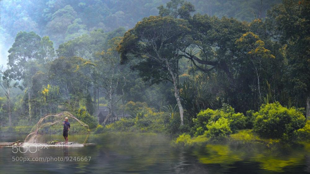 Photograph netting on misty lake by Irawan Subingar on 500px