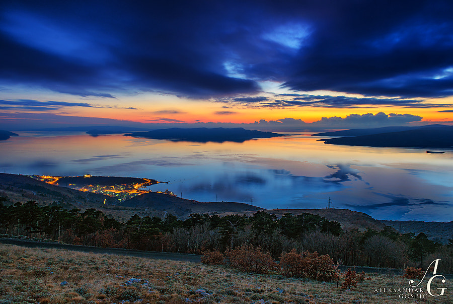 Twilight above Senj town tonight and calm seas in the Velebit Channel. Behind are the islands of Rab, Goli, Prvić and Krk