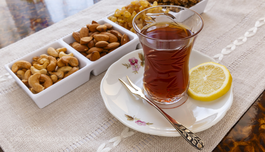 Photograph Azerbaijani tea with lemon and set nuts and sweets by Alexander Melnikov on 500px