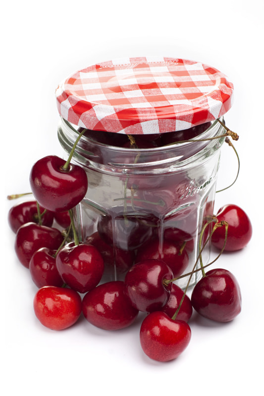 Photograph Cherries in a glass jar by Elena Rakhuba on 500px