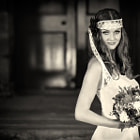 Постер, плакат: Beautiful Happy bride with wedding flowers bouquet in white dress with wedding hairstyle and makeup