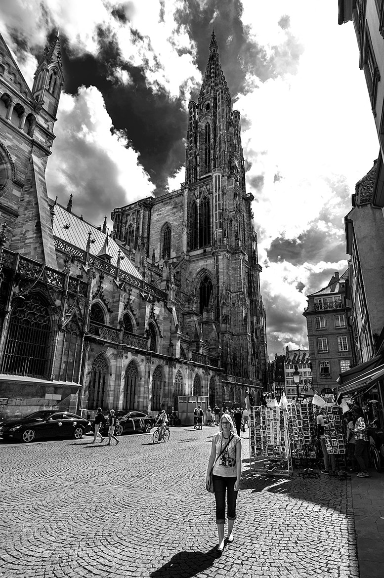 Photograph Simone in front ot he Strasbourg Cathedral by Darius K. on 500px