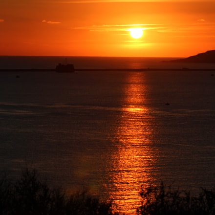 Sunset over plymouth sound breakwater