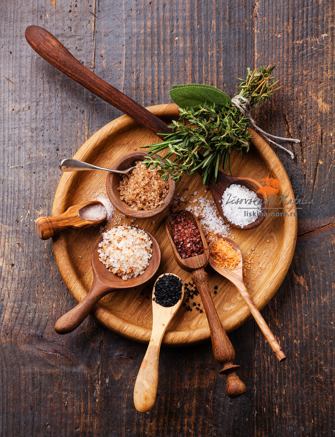 Different types of food coarse Salt in wooden spoons