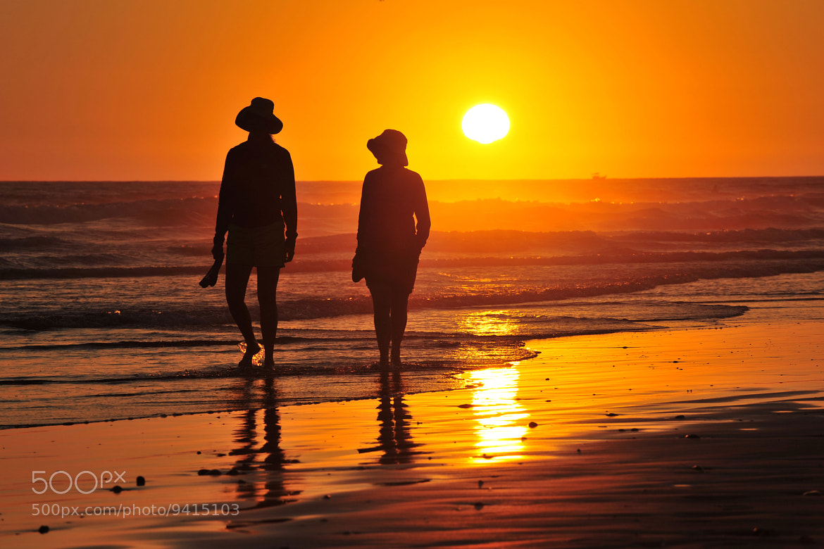 Photograph Couple Walks in the Surf at Sunset - Oceanside July 8, 2012 by Rich Cruse on 500px
