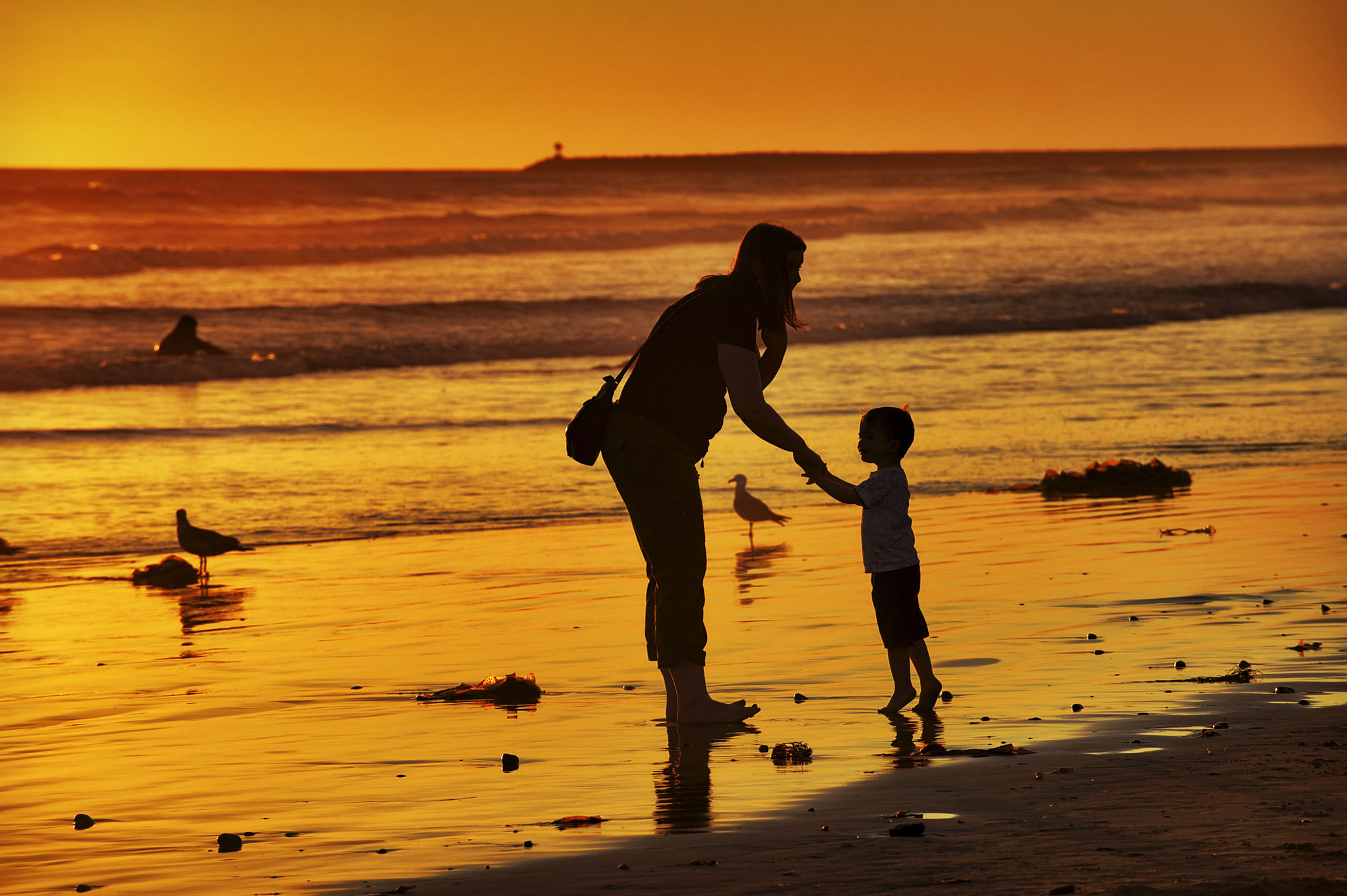 Photograph Mom and Son at Sunset in Oceanside- July 8, 2012 by Rich Cruse on 500px
