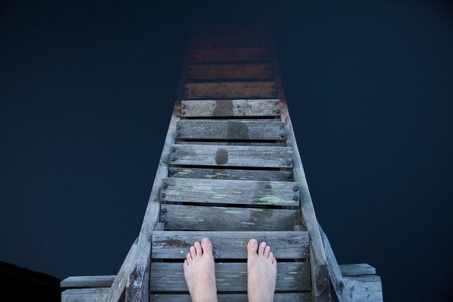 Standing on a pier by Miikka Poutiainen on 500px.com