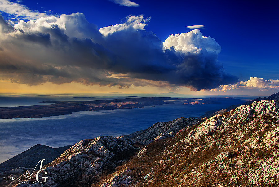 Small afternoon cell above the Pag island, viewed from the Velebit, 1000m above by Bura wind wrinkled sea surface in Velebit channel
