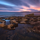 On a visit to south Cronulla one summer morning in 2009, the sky put on a show of streaking pinks, purples and blues.