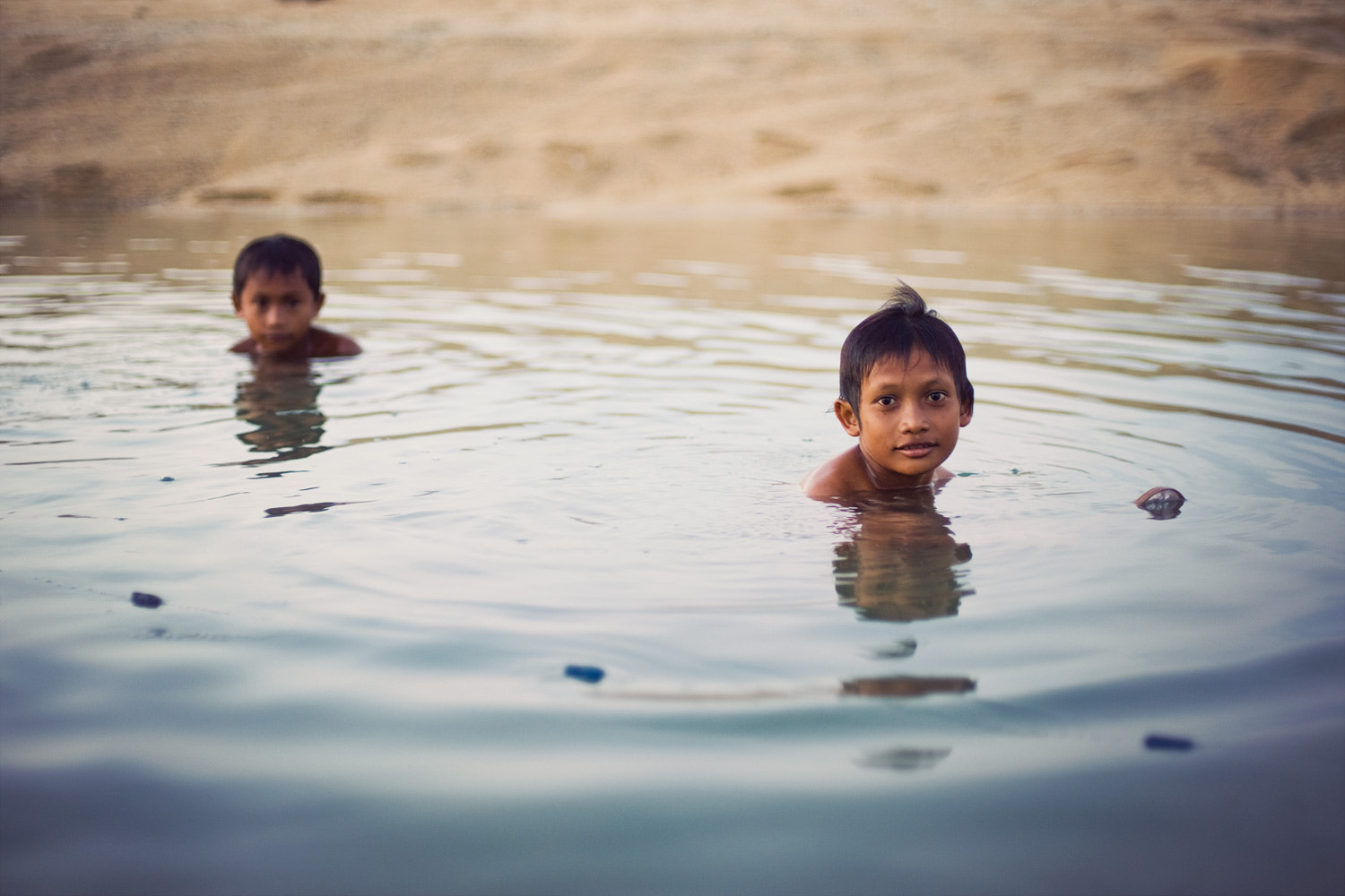 Photograph Children in a river by Raphaël Dupertuis on 500px