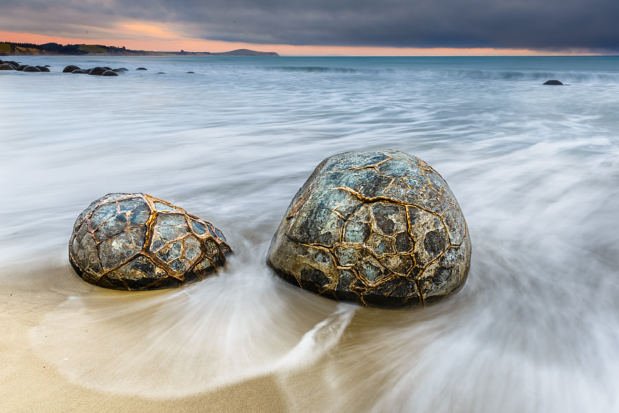 Moeraki Boulders on a cloudy sunrise