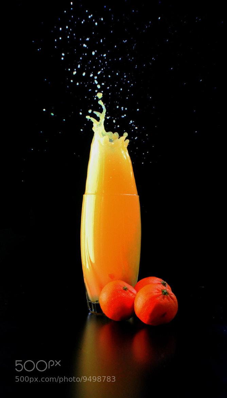 Photograph A splash of Orange juice by Divya  Das on 500px