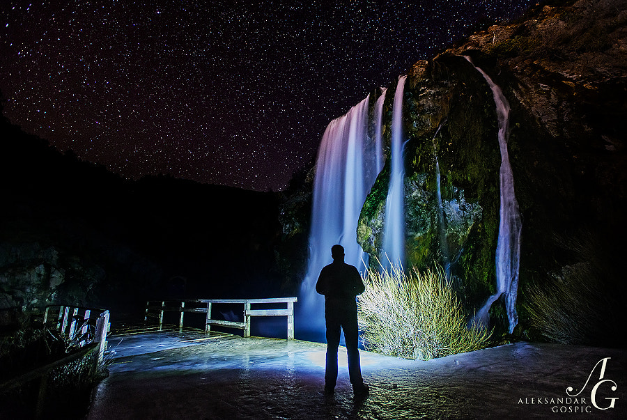 Stars and I observe 22m high Topoljski Buk waterfall on Krčić river as it crashes throught the cold winter night into the spring of Krka river near Knin