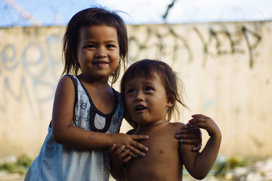 Photograph Early street portrait of children with a 50mm lens by Jeremiah Rogers on 500px