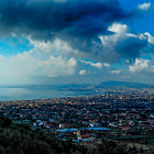 Постер, плакат: In memory of the musician Pino Daniele Clouds over Napoli