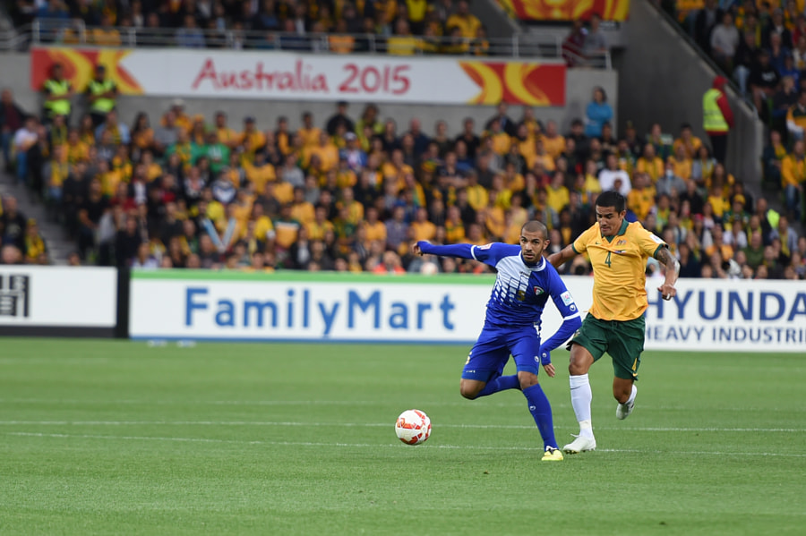 Photograph Tim Cahill chases Kuwait's Fahad Alhajeri by David Cooling on 500px