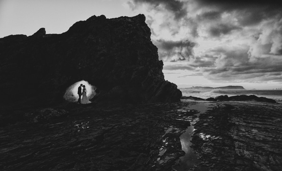 Photograph Silhouette of Bride and Groom at a stormy beach by Van Middleton on 500px