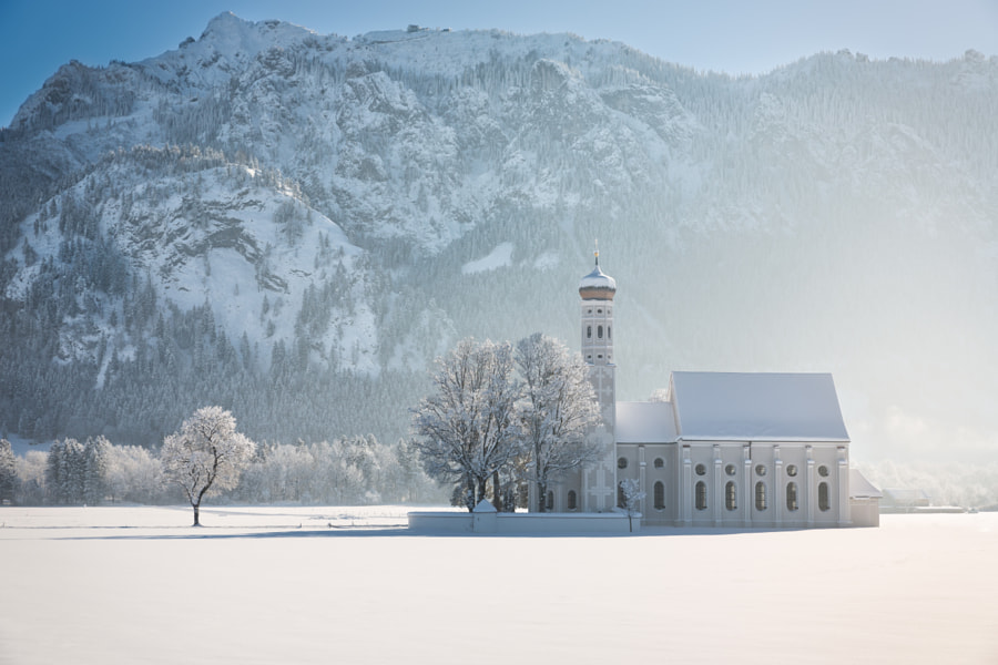 Photograph St. Coloman with trees in winterly landscape, Alps, Germany by Frank Fischbach on 500px
