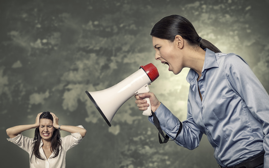 Woman Shouting Using Megaphone to Stressed Woman by Lars Zahner on 500px.com