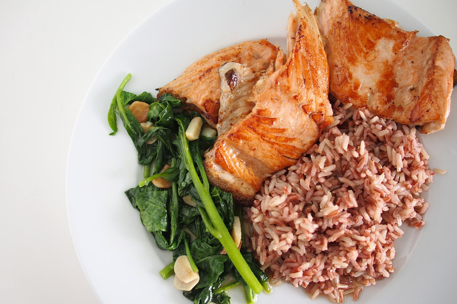 Photograph Pan-fried salmon bones, organic spinach, red rice by parentheticalpilgrim on 500px