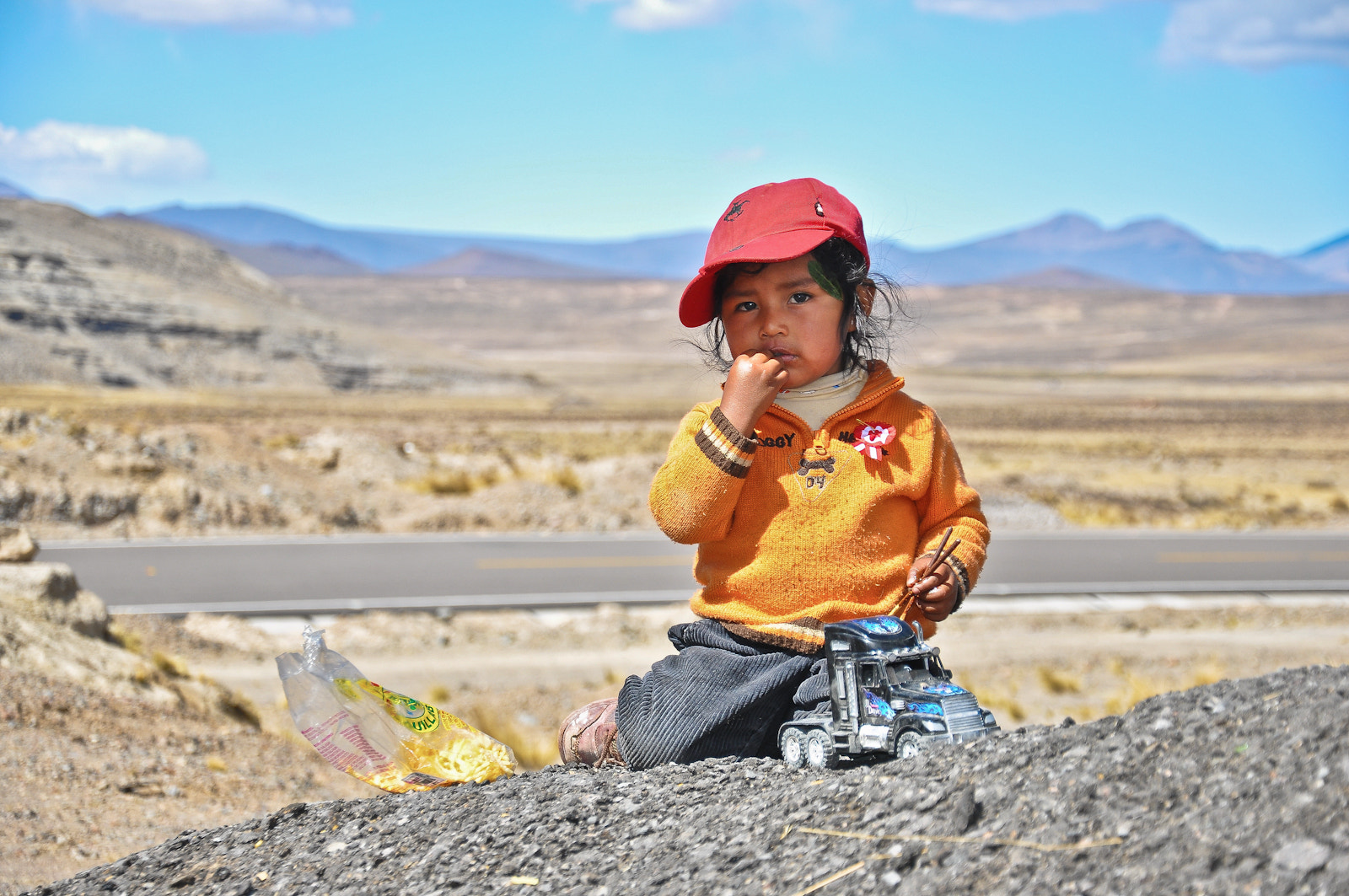 Photograph Peruvian girl playing with truck by Rui Carvalho on 500px