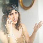 Постер, плакат: Flapper girl talking on a modern smartphone
